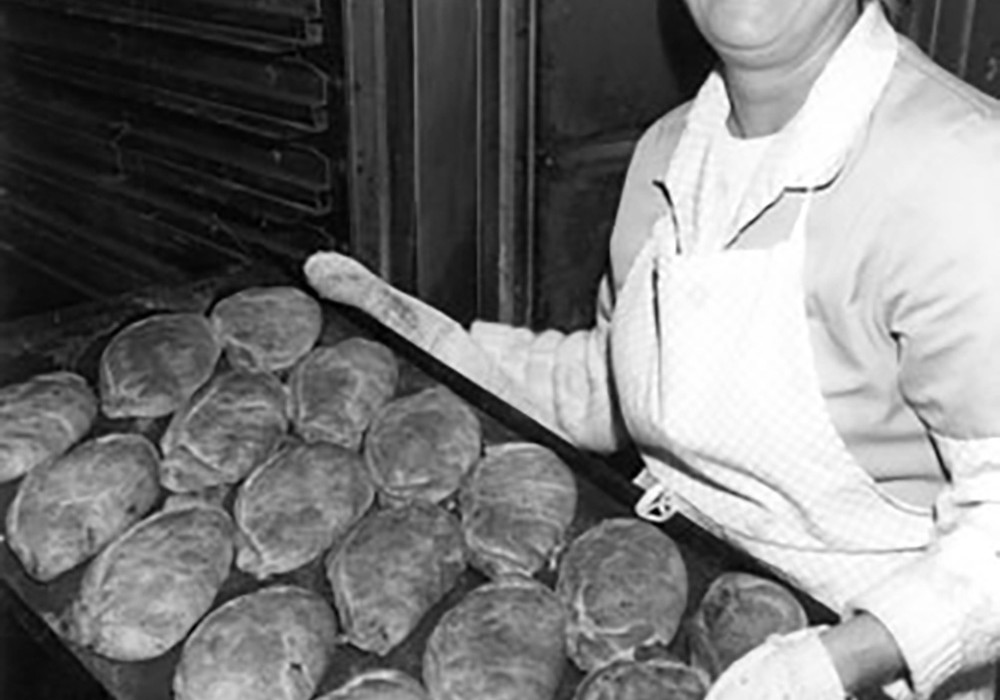 Evelyn Bothma with a tray of freshly baked pasties
